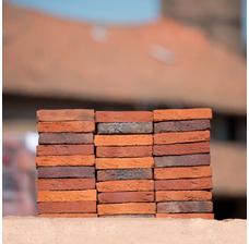 Кирпич ручной формовки STEENFABRIEK Vogelensangh Antigoon oranje rood paars gesinterd